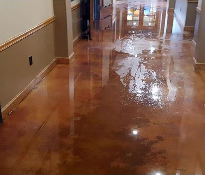 water covering floor in hallway