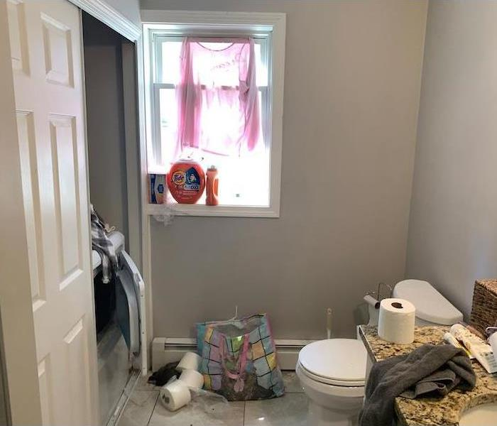 Bathroom with items on the tile floor