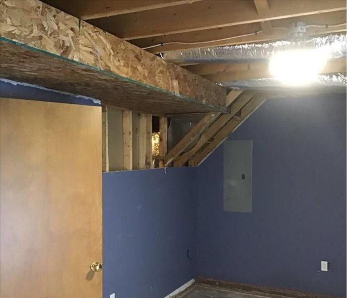 Exposed beams, particleboard apron, removed carpet, and some