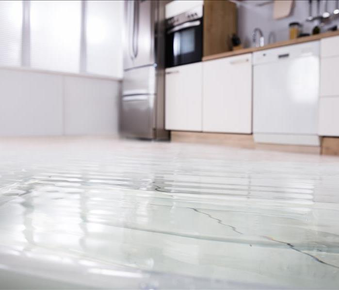 excess water on the floor of a kitchen