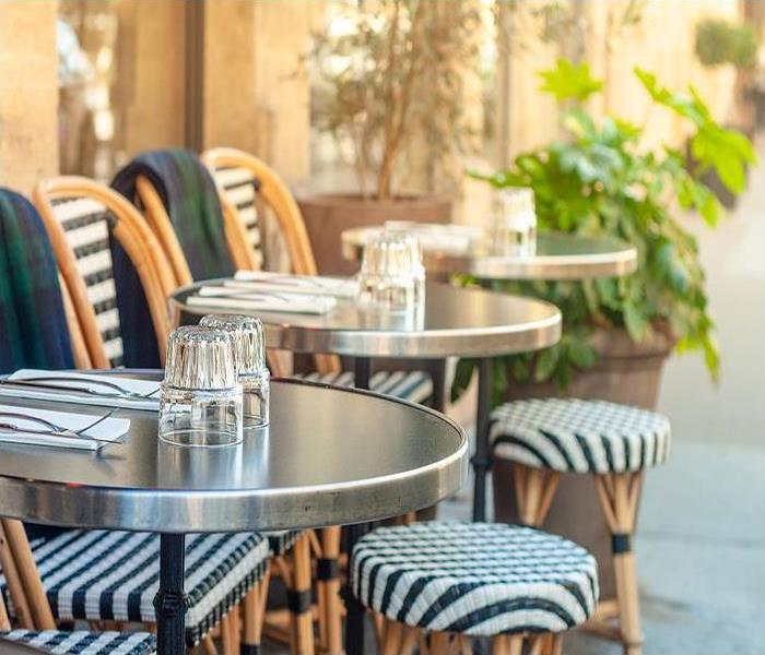 sidewalk cafe with outdoor tables